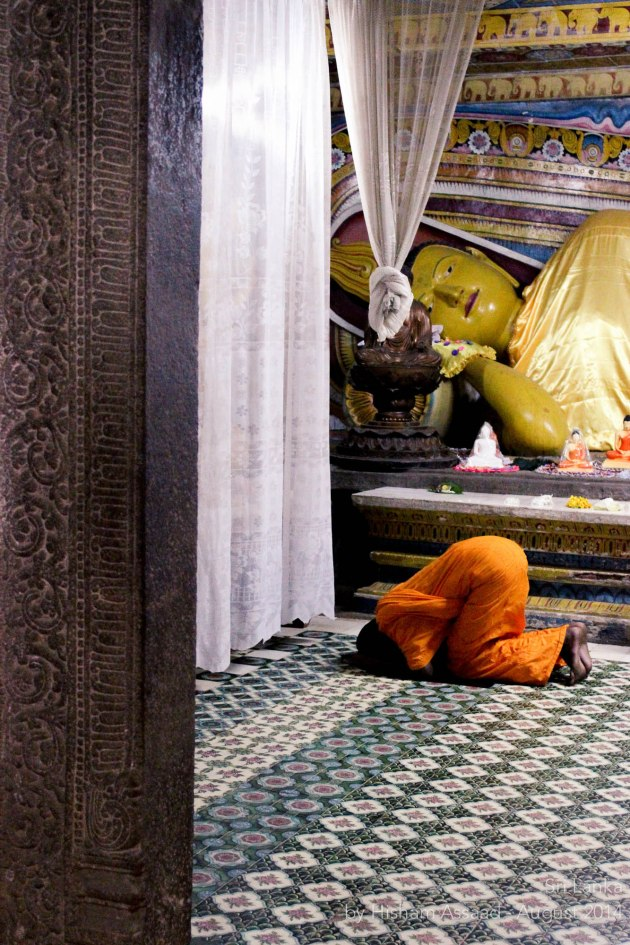 A praying monk - Inside the Temple of the Sacred Tooth