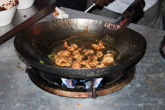 Sizzling prawns in the making